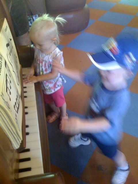 James and Isabel rock out on Goofy's piano