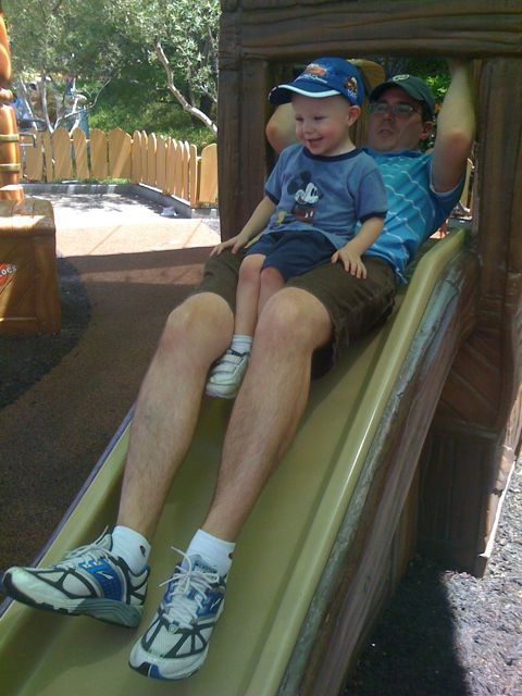 Joel and James ride the slide at Goofy's house in Toon Town